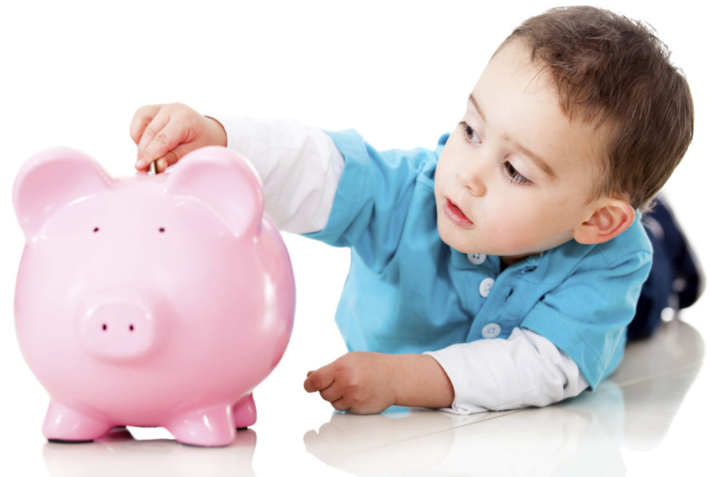 Little Boy With Piggy Bank